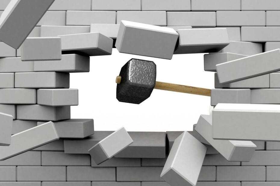 wall being smashed with hammer